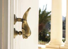 Maltese dorr knocker on palace Stock Photos
