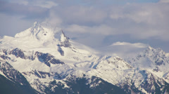 Stock Video Footage of Beautiful Craggy Alaskan Mountain Crags Looming in Clouds