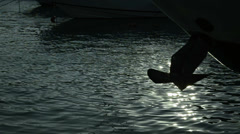 Black boat anchor, silhouette, sunset, yacht, poop, stern - stock footage