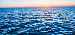 Riding on a ferry boat at sunset Stock Photos