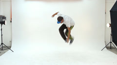 Young man dancing for the film clip in studio Stock Footage