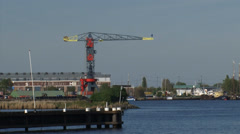 View across IJ at former NDSM shipyard and Faralda NDSM Crane Hotel Stock Footage