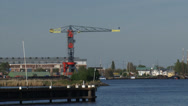 Stock Video Footage of View across IJ at former NDSM shipyard and Faralda NDSM Crane Hotel