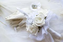 First holy communion candle gloves and medal Stock Photos