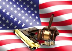 Gavel and hand gun with american flag Piirros
