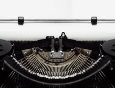 Typewriter with blank document paper Stock Photos