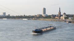 Barges on the Rhine river in Dusseldorf, Germany Stock Footage