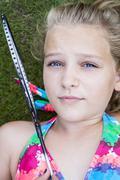 Child with badminton racket Stock Photos