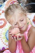 Child with a peach Stock Photos