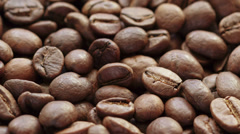 Falling coffee beans closeup, made from raw Stock Footage