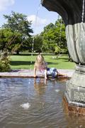 girl next to fountain - stock photo