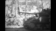 Soldiers travelling in military tank on street Stock Footage