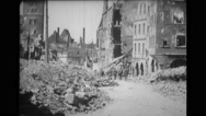 Soldiers walking on street passing through damaged buildings Stock Footage