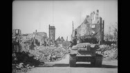 Military tanks rolling on street passing through damaged buildings Stock Footage