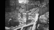 Soldiers walking through the debris Stock Footage