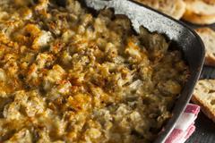 Homemade cheesy garlic artichoke spread Stock Photos