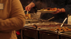 Various People Getting Food From a Buffet Stock Footage