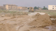 US-Army - Base Engineers - Afghanistan Bagram - Construction Vehicle driving 02 Stock Footage