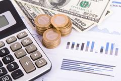 Stock Photo of financial charts and graphs on business table
