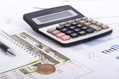 Financial charts and graphs on business table Stock Photos