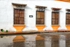 colonial facade and reflection - stock photo