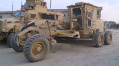 US-Army - Base Engineers - Afghanistan Bagram - Construction Vehicle driving 09 Stock Footage