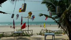 India Goa District Utorda beach 012 colorful lanterns in front of beach view - stock footage