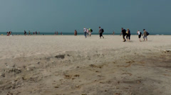 India Goa District Utorda beach 019 tourists walk on the wide beach - stock footage
