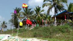 India Goa District Utorda beach 018 tourists are entering the beach - stock footage