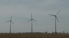 4K UHD 60fps - 3 wind mills side by side with blades turning Stock Footage