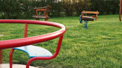 carousel spins on the playground - stock footage