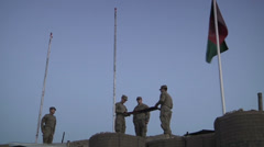 US-Army - Infantry Division - Chora Valley Afghanistan - Removing Flag 02 Stock Footage