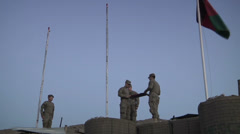 US-Army - Infantry Division - Chora Valley Afghanistan - Removing Flag 03 Stock Footage