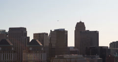Helicopter flying over Downtown Cincinnati buildings 4k Stock Footage