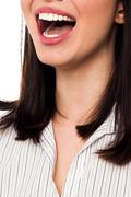 Cropped image of a joyous woman - stock photo