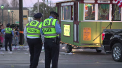 Two New Orleans police man standing in Endymion route Stock Footage