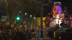 Float making turn at end of street on Endymion route Stock Footage