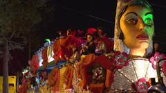 Carmen float Krewe throwing beads into crowd Stock Footage
