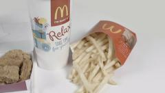 Fast food chicken nuggets fries and drink rotate Stock Footage