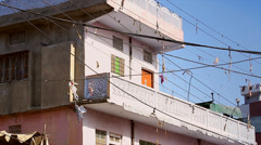 Wires and garbage are strewn everywhere through the air in Jaipur, India. Stock Footage