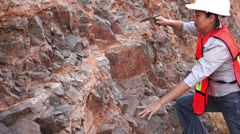 Female Mining Prospector Rock Chipping Stock Footage