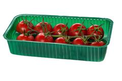 Cherry tomatoes organized in basket Stock Photos