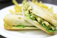 Close up of chicken sandwhich, soft focus, blurred background Stock Photos