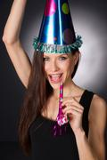 happy celebration attractive adult woman noise maker party hat - stock photo