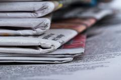 Stock Photo of close up newspapers