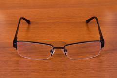 eyeglasses on table - stock photo