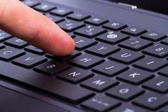 Stock Photo of finger on key