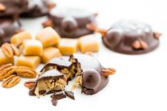 caramel pecan turtles - stock photo