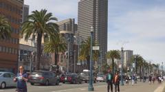 People enjoy travel walk promenade avenue San Francisco bay building tourist car Stock Footage