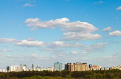 Blue sky with clouds over residential district Stock Photos